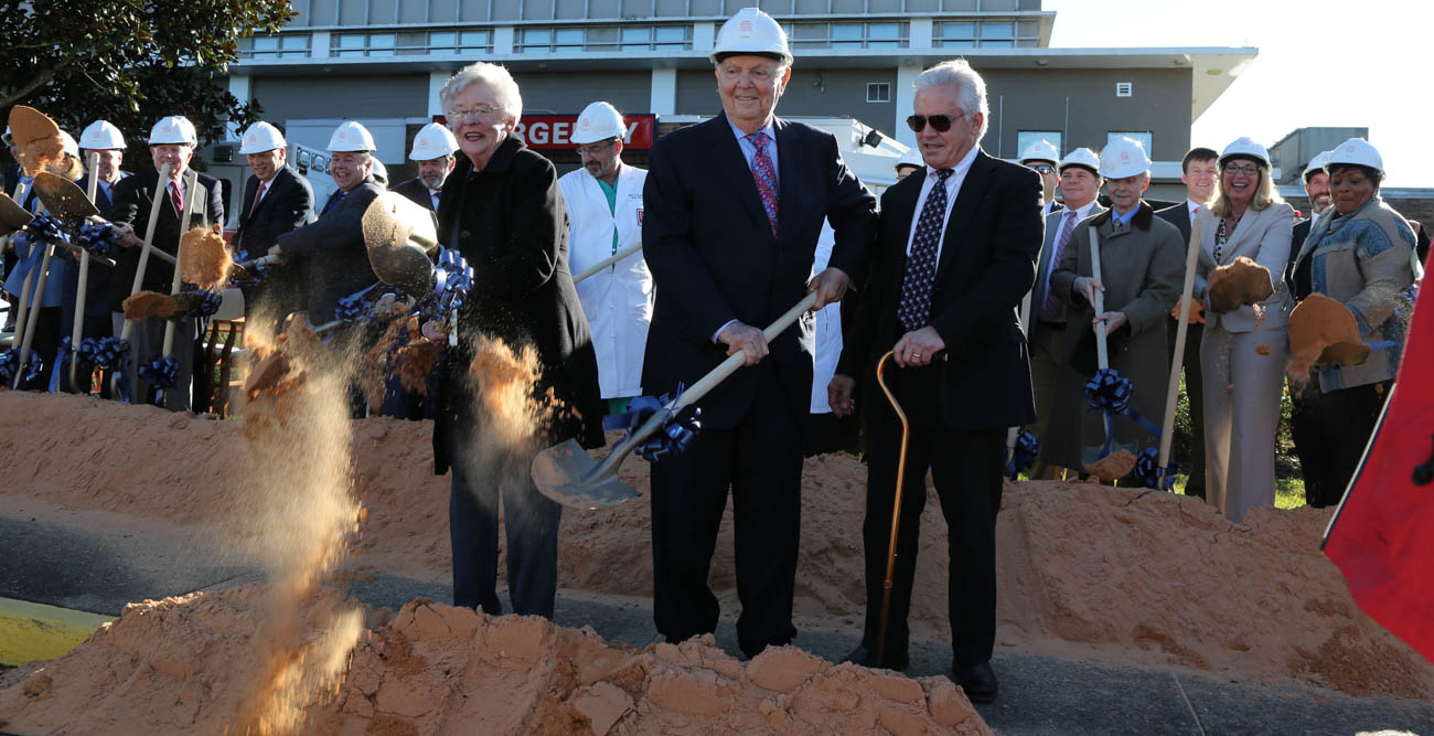 Gov. Kay Ivey and Bert Meisler, center, broke ground Tuesday on the Fanny Meisler Trauma Center at University Hospital. data-lightbox='featured'