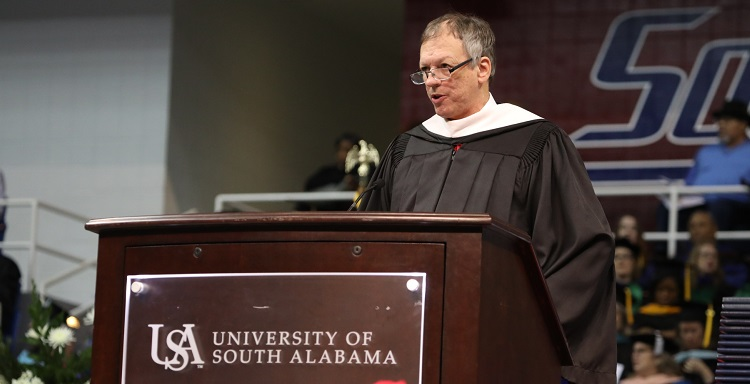 USA Writer-in-Residence Frye Gaillard told graduates they must find a way to cross barriers and heal divisions.