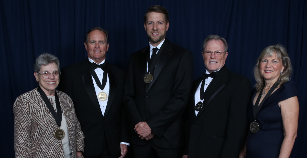 The University of South Alabama National Alumni Association honored four alumni and a Mobile businessman for outstanding accomplishments. There are, from left, Sr. Marilyn Joyce Aiello, O.P., M.D.; Ralph A. Hargrove; Caleb Crosby, '03; Dr. Edward A. Panacek, COM '81; and Tanya Fratto Blair, '83.