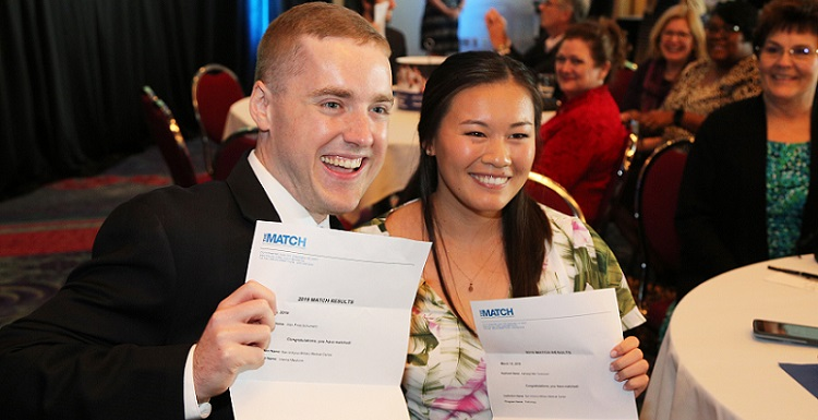 Seventy-seven senior medical students from the University of South Alabama College of Medicine gathered Friday in the Grand Ballroom at the Mobile Convention Center to open their letters from the National Resident Matching Program and find out where they will be continuing their medical education.  data-lightbox='featured'