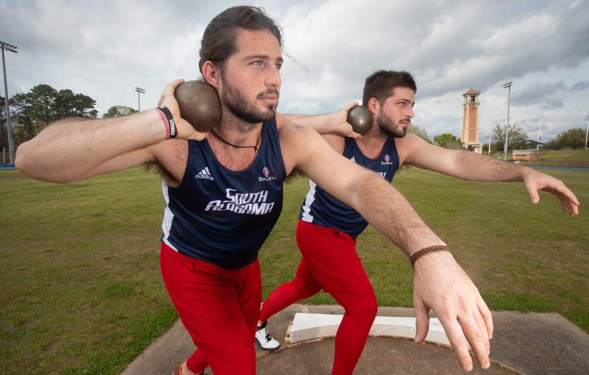"Twin brothers Ethan Boyd, left, and Thomas Boyd are first-year medical students at the University of South Alabama College of Medicine and athletes on the USA men's track and field team. ""With us being so close and doing everything the same, part of that is competing against each other,"" Thomas says."