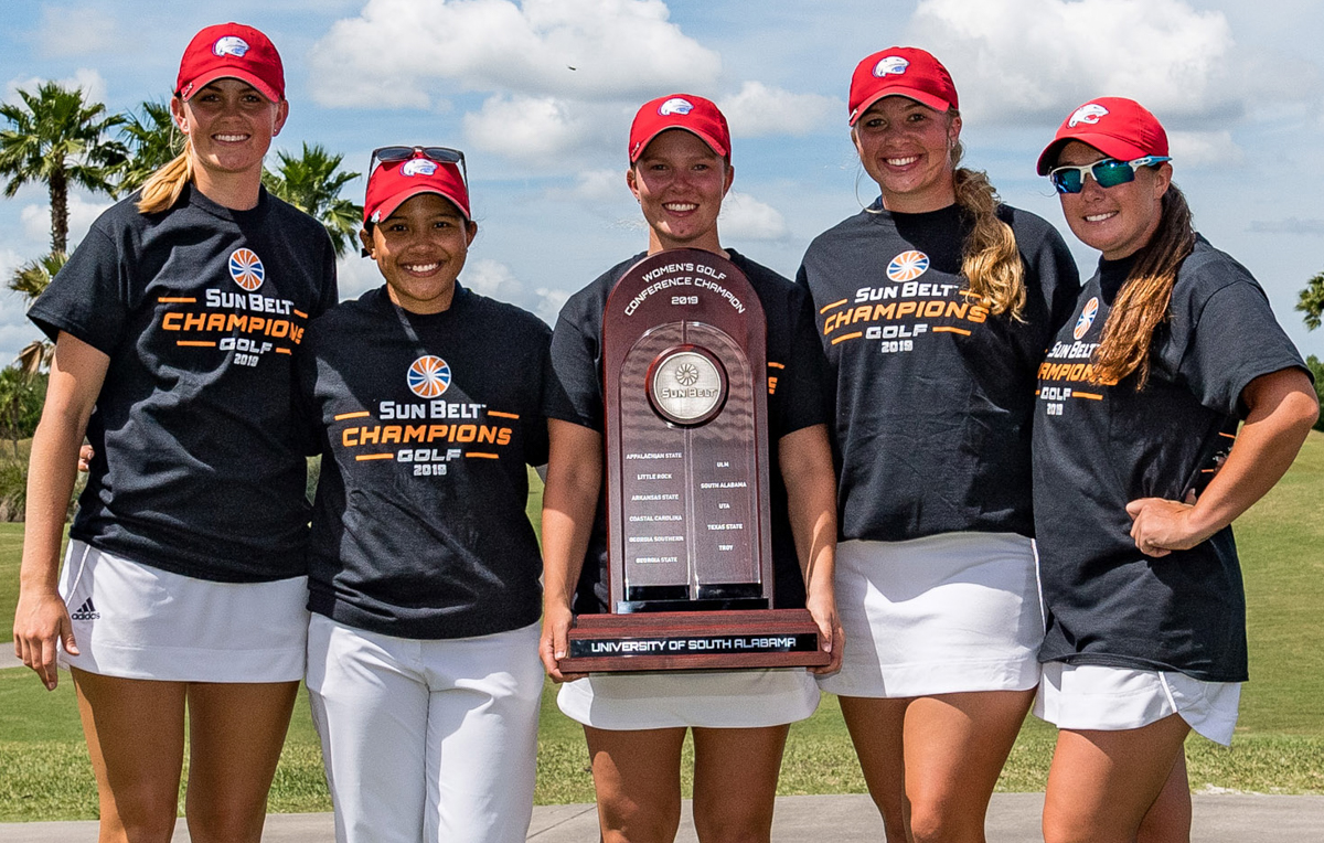 The women's golf team – from left, Caroline Berge, Lexi Worrell, MacKenzie Peyton, Julie Hovland and Siti Shaari, with Coach Matt Luther – claimed the Sun Belt Conference championship when it finished with a season-low 877 combined score at the LPGA International – Hills Course.