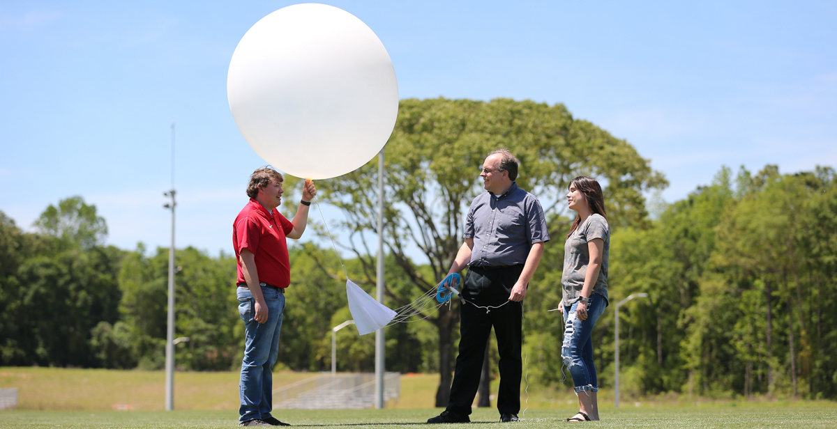 Dillon Blount, left, a senior meteorology major from Pelham, Ga.; Dr. Wesley Terwey, assistant professor of meteorology; and Amber Kulick, a junior meteorology major from Falkville, Ala., participate in the VORTEX weather balloon program that seeks to learn more about tornadoes in order to provide timelier forecasts.