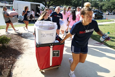 Student organizations and teams participated in Move-In Day to help welcome new students and move them into campus housing.