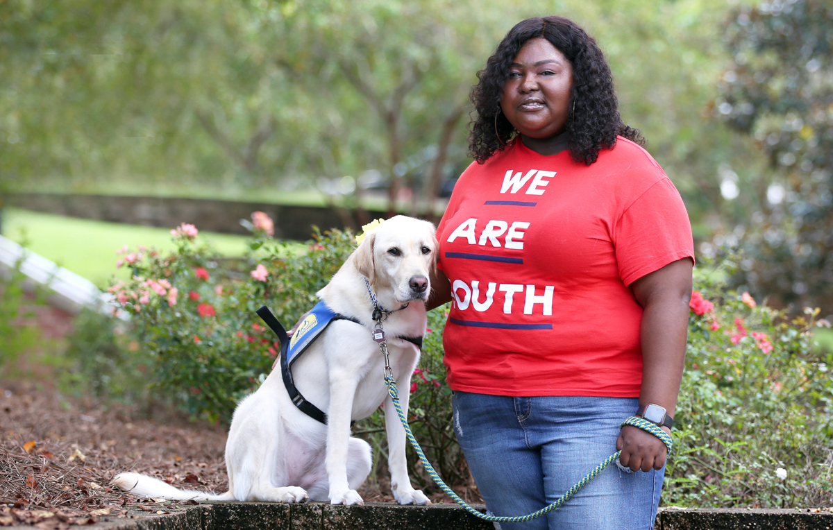 Kearria Freed, a transfer student pursuing a degree in interdisciplinary studies, uses Darling, her 2-year-old Labrador/Golden Retriever service dog, to navigate South's campus.