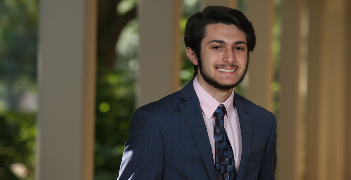 Stephen Azar, second from right, is the University of South Alabama Board of Trustees Scholar for the 2019-2020 academic year. Azar is a freshman from St. Patrick High School in Biloxi, Miss. The scholarship is awarded annually to the most academically talented student in each incoming freshman class at USA. Joining Azar at the USA Board of Trustees meeting are, from left, 2018 scholar Cody Dunlap of Mobile, 2017 recipient Ada Chaeli van der Zijp-Tan of Madison, Ala., 2016 recipient Christian Manganti of Gulfport, Miss., Board of Trustees chair pro tempore Jimmy Shumock; Rana Azar, Stephen Azar's mother; Azar, and University President Tony Waldrop.