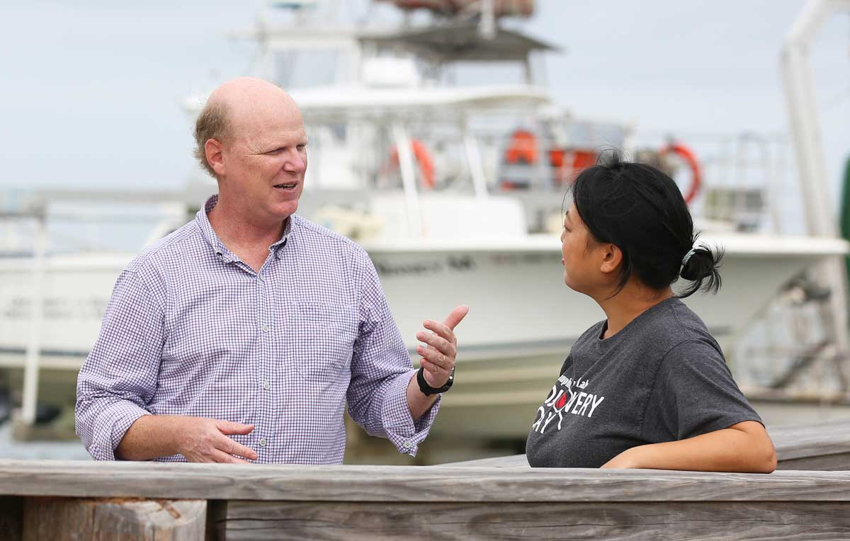 """Dr. John Lehrter, associate professor of marine sciences, and Ph.D. student Mai Fung will take part in a study to determine how oyster, blue crab and speckled trout respond to changes in their environment. """"We're looking at how do we manage the ecosystem both from the bottom up – water quality and habitat quality – and top down – fisheries management,"""" Lehrter said."""