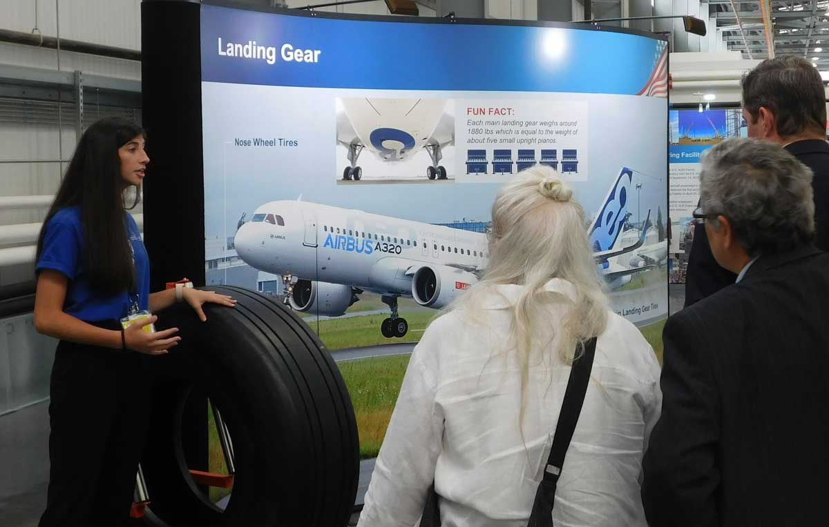 Emily Fogt, a freshman from Sidney, Ohio, explains to her tour group how the wings are attached to an Airbus plane. Fogt was among ten University of South Alabama hospitality and tourism management students who led tours of the Airbus Final Assembly Line facility for a recent conference.