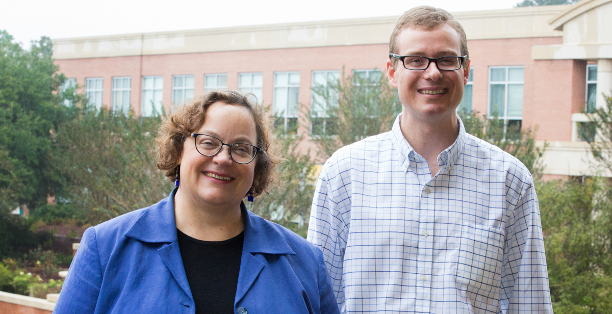 Dr. Laura Moore, left, associate professor and chair of music, and Dr. Silas Leavesley, professor of chemical and biomolecular engineering, were named respectively as Phi Kappa Phi's artist and scholar of the year.