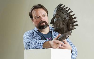 Fernando Guérard with an unfinished cold-cast version of his Chief Calvin McGhee bust.