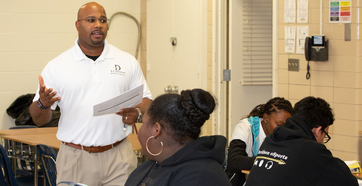 Ramsey Willis instructs students during a geometry class at Davidson High School in Mobile. Willis majored in business and worked in industry prior to completing his master's degree in education from South through the Robert Noyce Teacher Scholarship Program.
