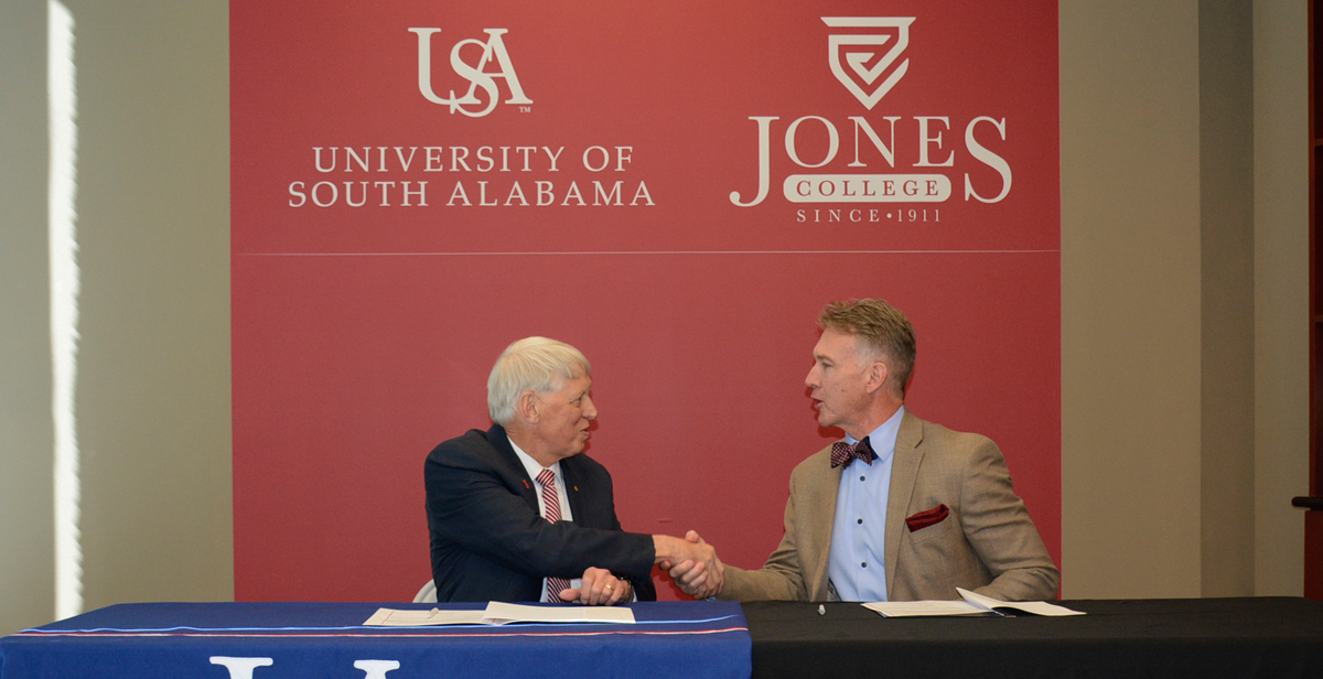 Dr. Tony Waldrop, left, president of the University of South Alabama, and Dr. Jesse Smith, president of Jones College, signed an agreement Friday that will expand access to a four-year degree through the Pathway USA program.