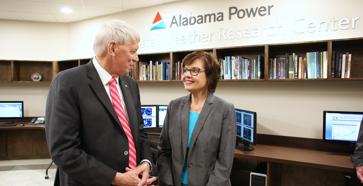 Dr. Tony Waldrop, University of South Alabama president, talks with Beth Thomas, corporate communications manager for Alabama Power, inside the new Alabama Power USA Coastal Weather Research Center. The center provides weather forecasting to more than 100 clients.