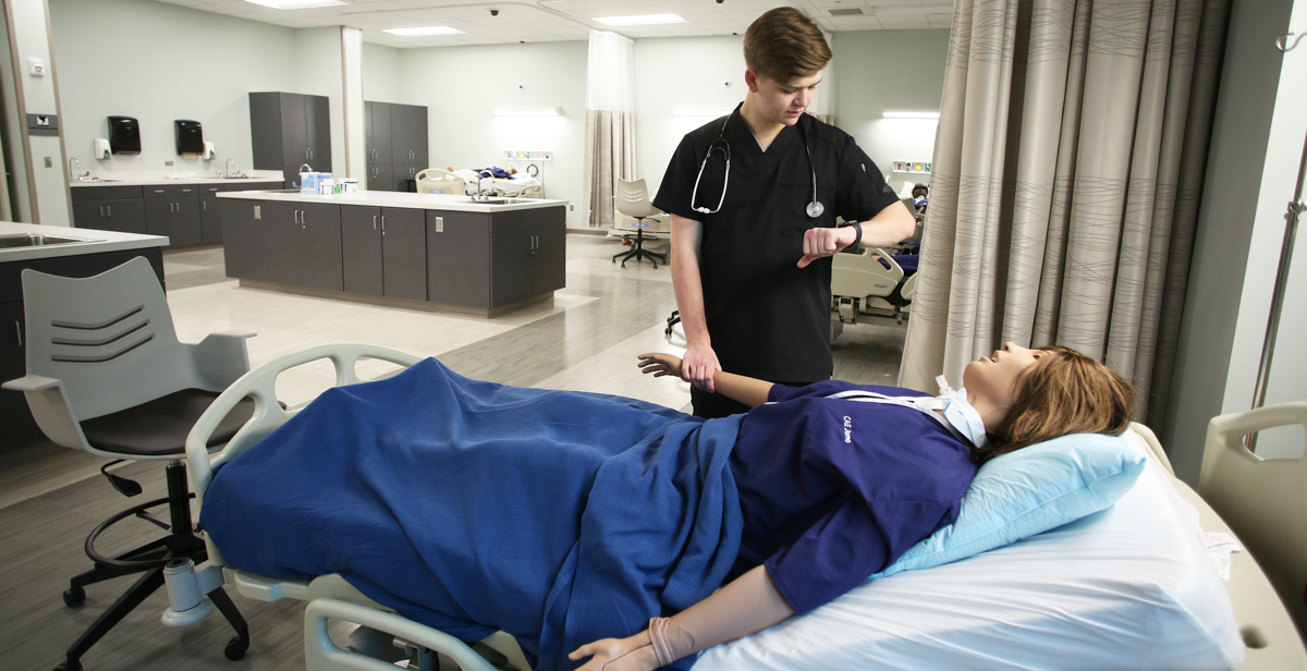Will Rayner, a professional health sciences major from Hoover, Ala., practices on one of the high-tech patient simulators in the new, 39,000-square-foot Simulation Building. The facility is used by South's nursing, allied health and medical students.