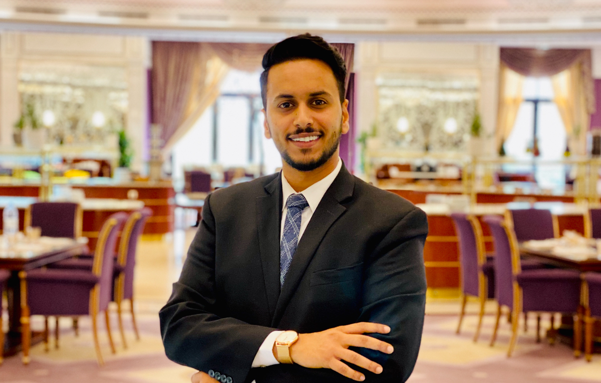 """Raed Alsulami, a University of South Alabama graduate in hospitality and tourism management and assistant manager for the main restaurant at the Ritz-Carlton Hotel in Riyadh, Saudi Arabia, credits his experiences as a student for his current success. """"I feel that the program at USA helped me get to where I am today and provided opportunities for me to maximize my goals in the industry,"""" he said."""