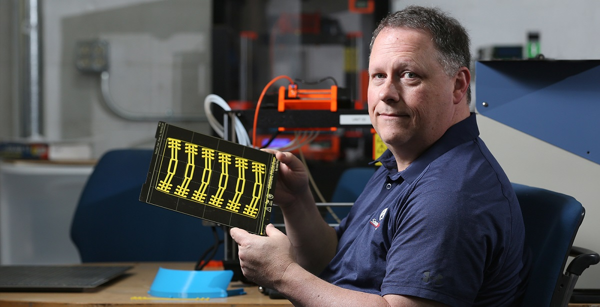 Ricky Green, an information technology instructor at the University of South Alabama, uses 3D printers to produce parts that will be put together to make face shields for healthcare workers.