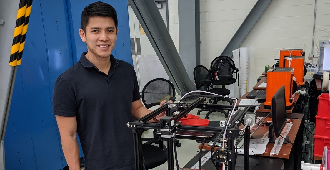 John Ding, who earned a master's in business administration from the University of South Alabama's Mitchell College of Business, is an aircraft engineer at Airbus and part of a team making medical masks for USA Health using 3D printers. Photo courtesy of Airbus.