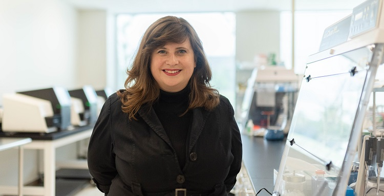 """Dr. Miranda Byrne-Steele, at her iRepertoire lab in Huntsville, leads a team of team of researchers exploring coronavirus therapies. """"It's taken years and years of experience and technology development, and we're applying it in a rapid way,"""" she said."""