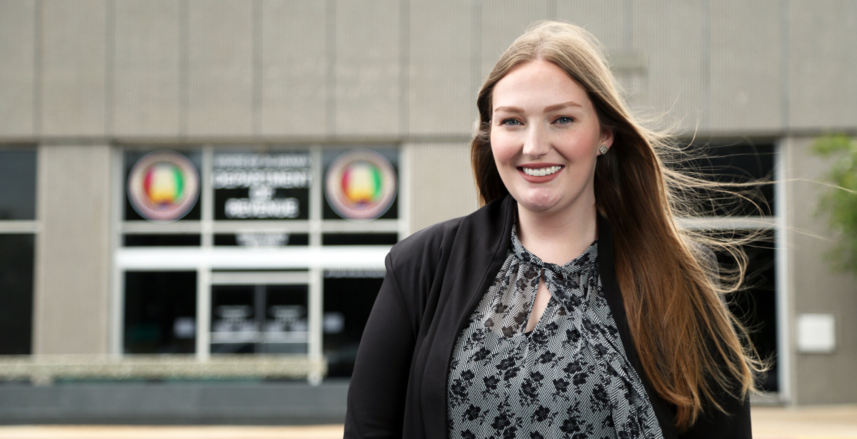 Amara Baltimore, a spring graduate of the Mitchell College of Business, is just 22 years old, but she's already conducting audits and interviewing taxpayers in her first job with the Alabama Department of Revenue.