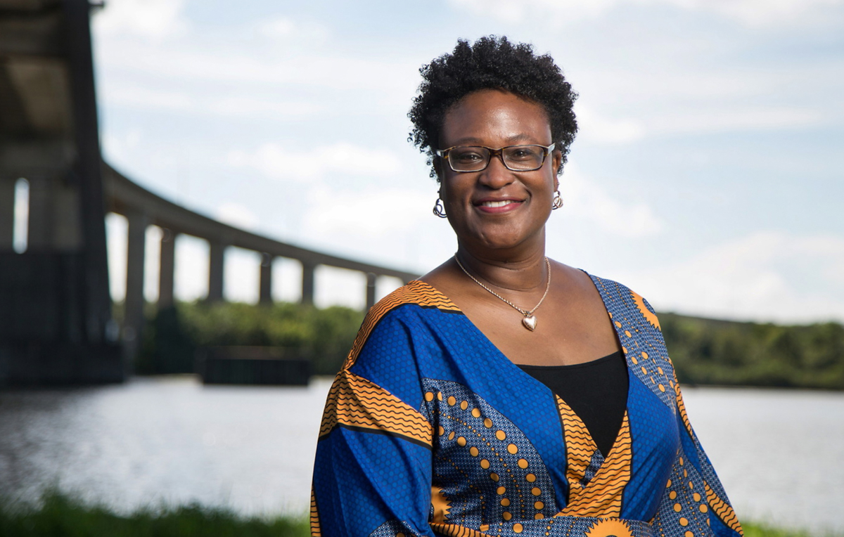 Dr. Joél Lewis Billingsley, associate professor in the University of South Alabama College of Education and Professional Studies, stands along the Mobile River in Africatown, where enslaved Africans aboard the Clotilda formed a community after arriving in America.