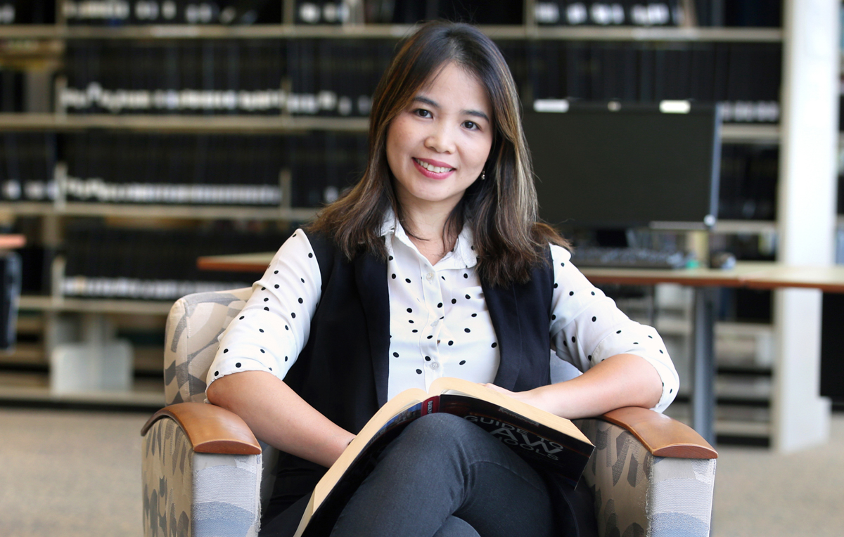 """Freshman Thanh Haas said the Marx Library is her favorite location on campus at the University of South Alabama. """"I like the view from the second floor. You can sit next to the big windows and look out over the lake,"""" she said."""