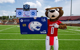 USA mascot SouthPaw shows off the new Hancock Whitney Jaguars branded debit card.