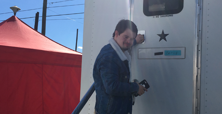 """Former South student Benjamin Pelham outside of his trailer on the set of the film """"Embattled."""""""
