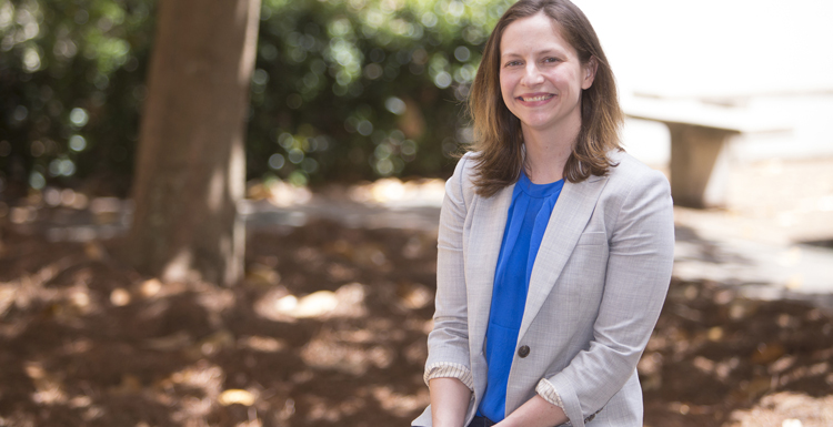 Dr. Claire Cage, associate professor of history and gender studies is one of 13 USA Office of Community Engagement and Service Learning Program Faculty Fellows.