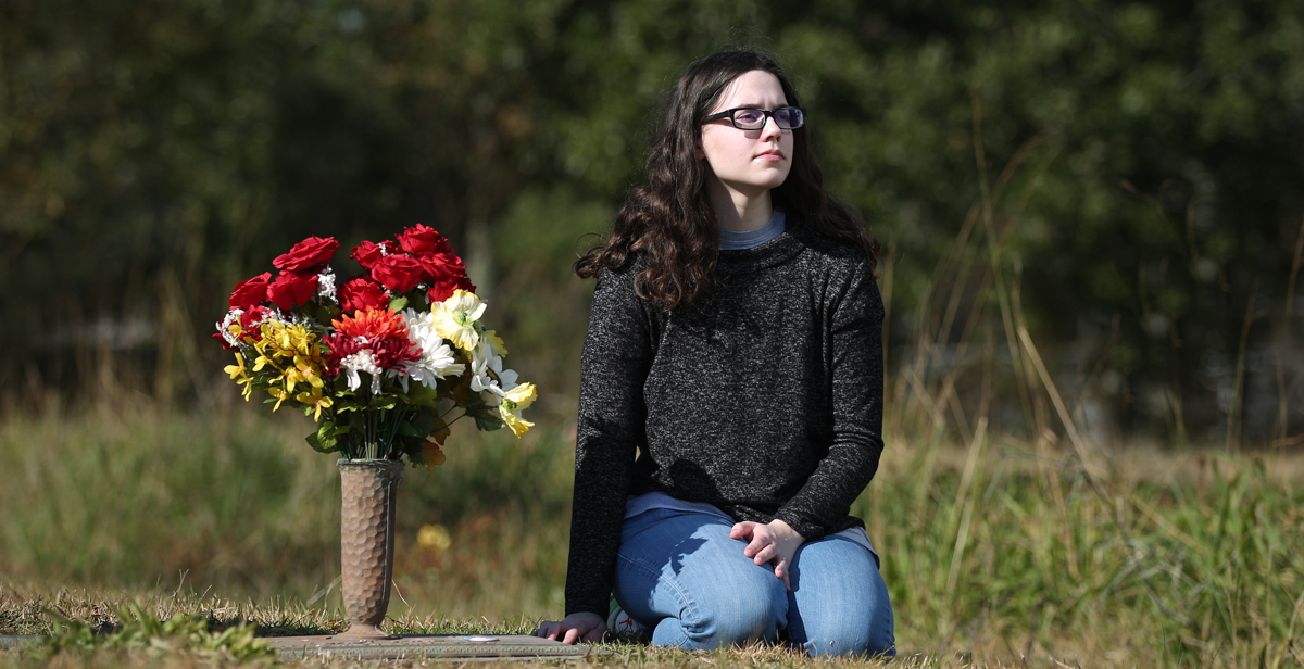 Olivia McCarter still visits the grave at Jackson County Memorial Park of Alisha Ann Heinrich after helping identify her using DNA samples and genealogy records. Next to the plot is the grave of another baby girl whose body has never been identified.