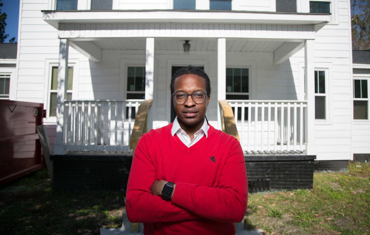 Terrance Smith stands in front of a house on Virginia Street that's being renovated through the work of the Mobile Innovation Team, a project funded by Bloomberg Philanthropies. The home at one point was used by Mobile's Pollman family as a kitchen for their bakery before they opened the nearby Pollman's Bake Shop, said Smith, the innovation team director and a University of South Alabama graduate.