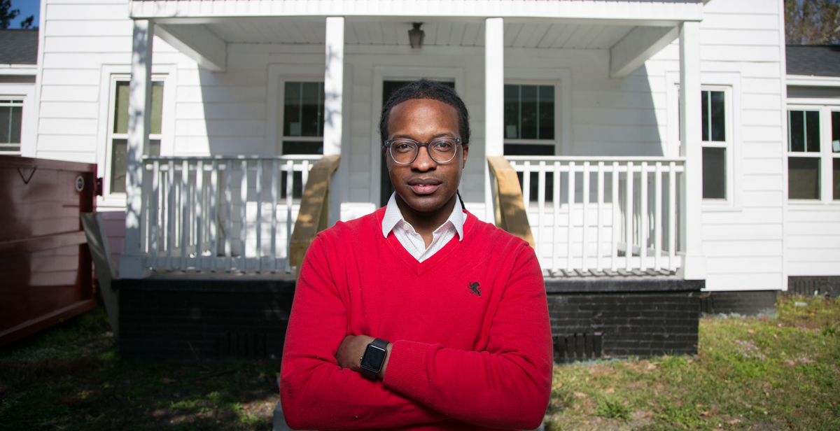 Terrance Smith stands in front of a house on Virginia Street that's being renovated through the work of the Mobile Innovation Team, led by Smith. The home at one point was used by Mobile's Pollman family as a kitchen for their bakery before they opened the nearby Pollman's Bake Shop, said Smith, a two time University of South Alabama graduate. data-lightbox='featured'