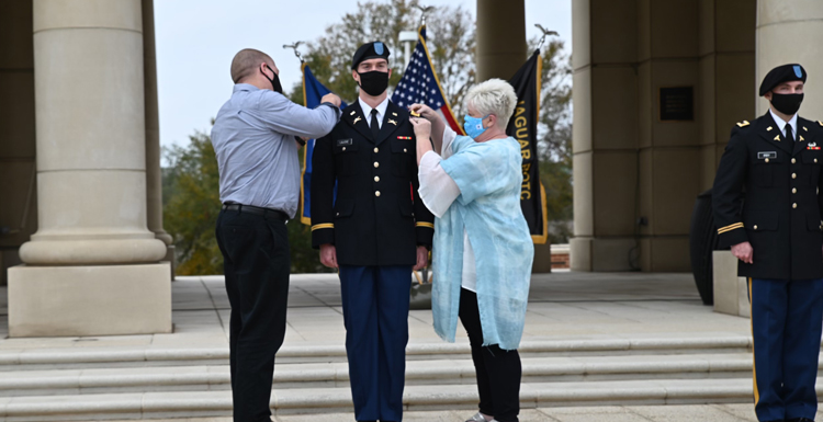 USA student 2nd Lt. Zachary LaJoie, a recent graduate, received his military commission after completing the USA Army ROTC program last fall. LaJoie's parents Steve and Bonnie pin his bars onto the uniform during the ceremony.
