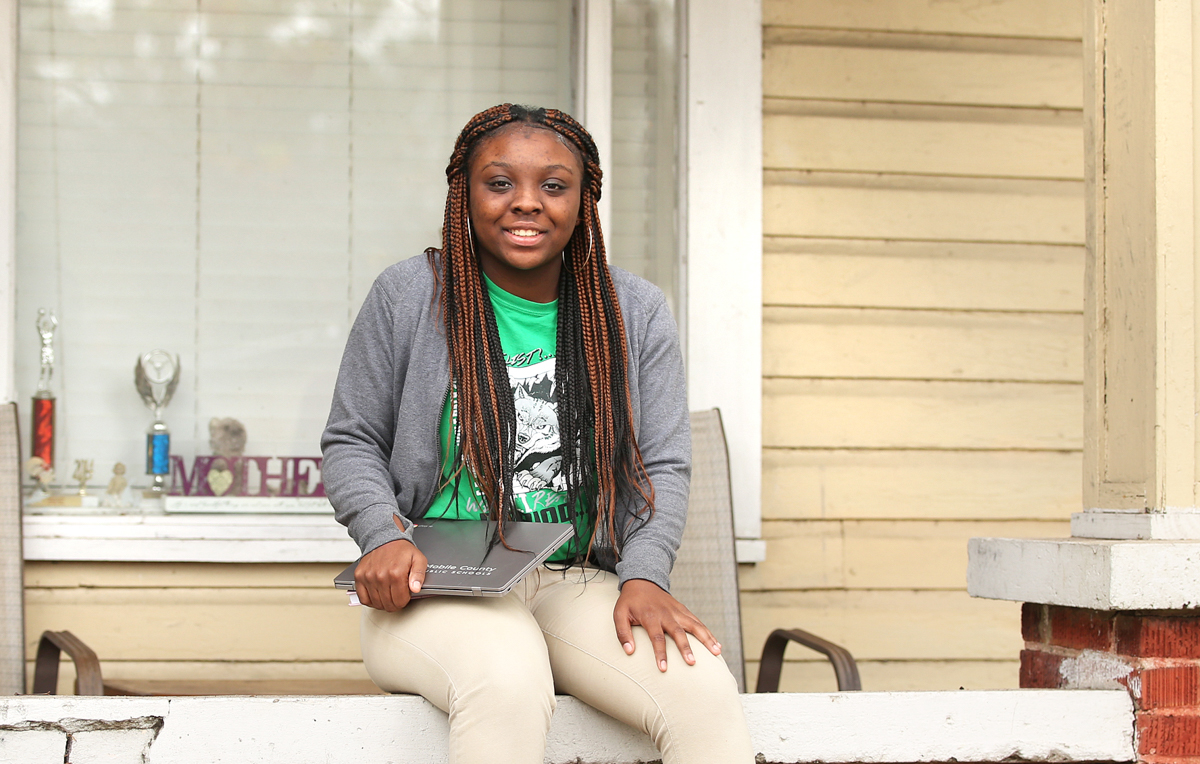 "Amre Davis, a Vigor High School student who is taking courses at the University of South as part of the Start South dual enrollment program, starts her schoolwork as early as 4 a.m. ""I get up, set up my laptop, maybe have a bowl of cereal, and get going on my assignments,"" she said."