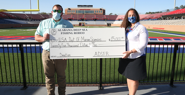 Cory Quint, 2020 President of the Alabama Deep Sea Fishing Rodeo and Crystal Hightower, senior research lab manager at the University of South Alabama School of Marine and Environmental Sciences.