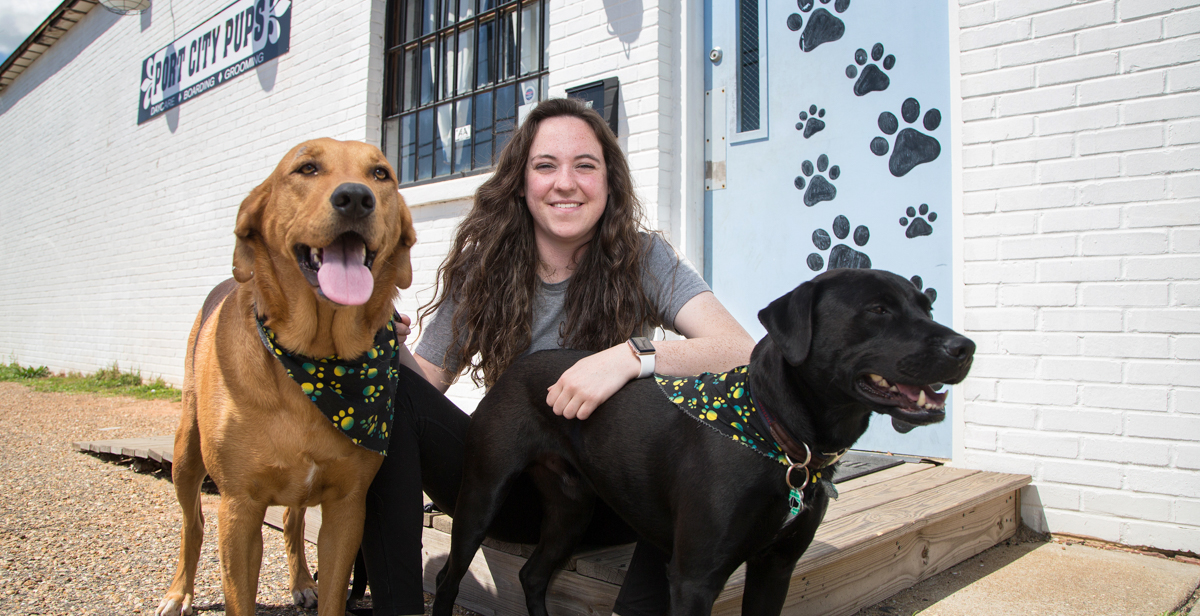 """Port City Pups owner Bailey Duos, who graduated from South's entrepreneur program last year, had to adjust expectations when dog boarding dried up during the pandemic. """"I definitely matured really fast. I'm a little more careful now,"""" she said."""