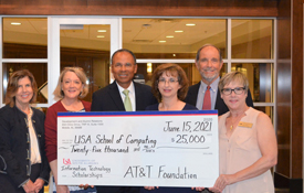 The AT&T Foundation donates $25,000 for the AT&T Aspiring Leaders in Information Technology scholarships. From left; Margaret M. Sullivan, V.P. Development & Alumni Relations; Lori Harris, development officer, School of Computing; Glyn Agnew, regional director, AT&T Alabama; Angela Clark, chair, department of Information Systems & Technology; Dr. Alec Yasinsac, dean, School of Computing; Melissa Smith, senior instructor & recruiting coordinator, department of Information Systems & Technology.