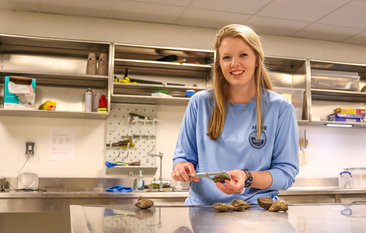 Merritt McCall's duties with the Mississippi Department of Marine Resources include building, seeding and monitoring oyster beds in state waters. she recently earned her master's degree in marine science from the University of South Alabama.