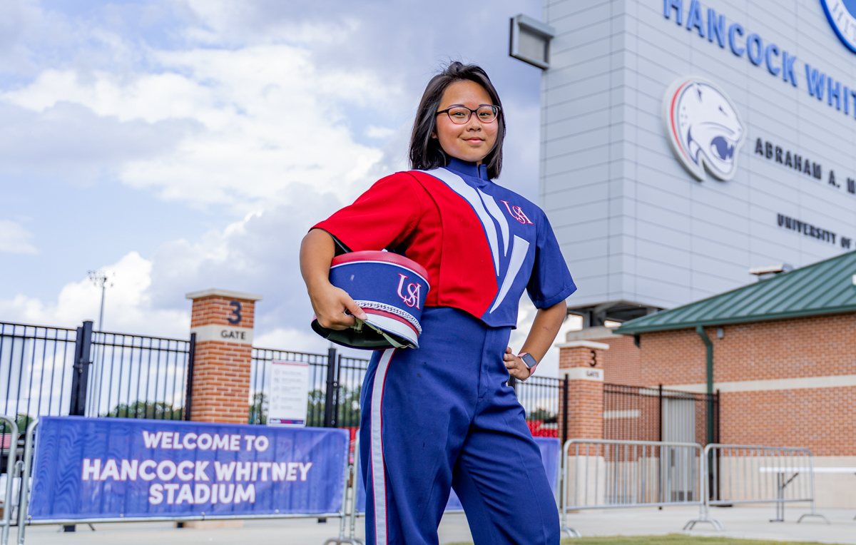 Anita Nguyen, an Honors College freshman, says a lot goes into an on-field marching band routine. The experience is energizing.