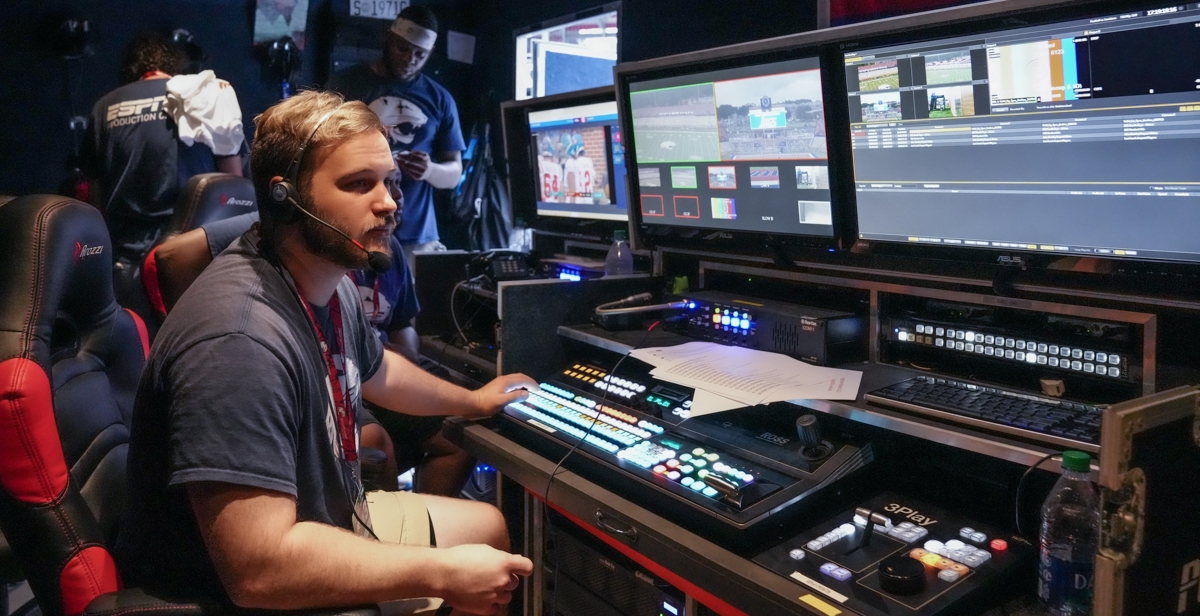 Chris Hites, a junior majoring in communications, works as a replay operator with other members of the student ESPN+ broadcast team in the control booth during Saturday's game against the University of Louisiana at Lafayette.