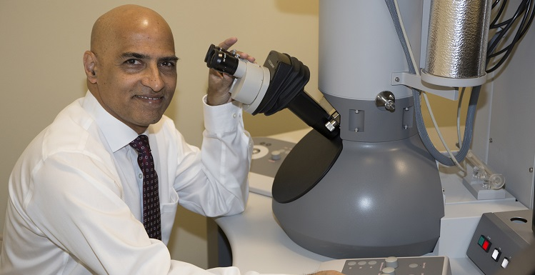 Dr. Srinivas Palanki, professor and chair of chemical and biomolecular engineering, with the University?s new Transmission Electron Microscope, which will allow researchers to examine structure, composition and properties of materials at a scale of a nanometer.