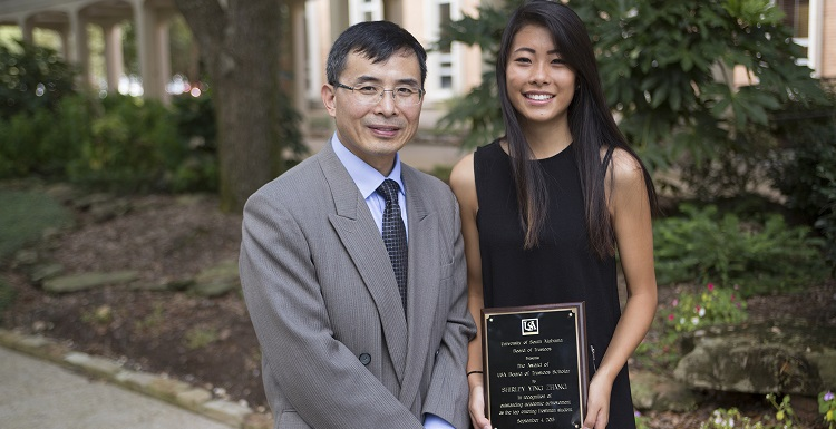 USA Board of Trustees Scholar for 2015-2016, Shirley Zhang of Vestavia Hills, Ala., is pictured with her father, Rusheng Zhang, after receiving her scholarship from the USA Board of Trustees.