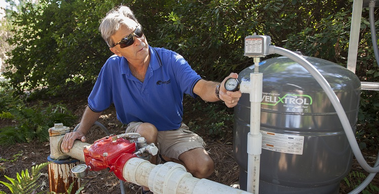 Landscaping Manager Gary Carley checks the campus wells daily.  Carley and his employees use the wells for irrigation purposes, such as watering grass and flowers, but the well water is also used in the generation of the chilled water used to cool the campus buildings.