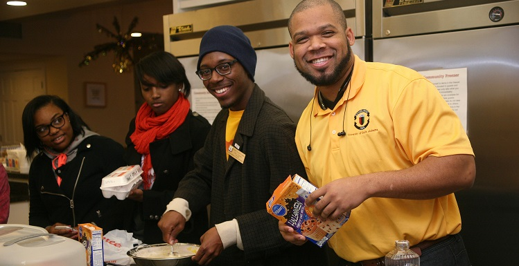 USA African American Student Association members teamed up to bake cakes and cupcakes and organize toys for ill and injured children and their families at Ronald McDonald House. AASA President DeWitt Ford, marketing major, far right, vounteers with Service Chair Carl Thomas, marketing major, and other members of AASA.