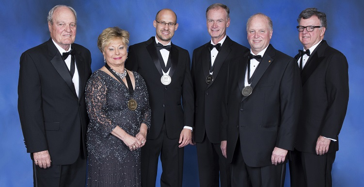 """Recipients of the 2016 Distinguished Service Award are, from left, Dr. James E. Laier, associate dean of the USA College of Engineering, and his wife, Diana Laier,'83, retired treasurer  and chief financial officer of their company Southern Earth Sciences Inc. Recipients of the Distinguished Alumni Award are, continued from left, Jonathan L. Hursh, '04, founder and president of Included and Utopia; Dr. Mark S. Williams,'80, chief physician executive with Tenet Healthcare/Brookwood Medical Center; James """"Jimmy"""" Shumock, '80, chief executive officer of Thompson Holdings and Thompson Engineering, member of the USA Board of Trustees; and the V. Gordon Moulton Distinguished Service Award recipient is Christopher L. Lee, executive director of the J.L. Bedsole Foundation."""