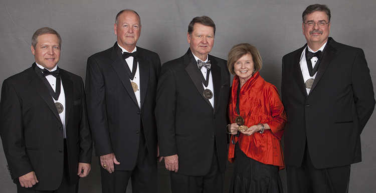 The University of South Alabama National Alumni Association honored five people Thursday evening at the 2015 Distinguished Alumni and Service Awards Dinner held in the Mitchell Center. Accepting the awards, from left, are: Greg Gabel, Distinguished Alumni Award; W. Andrew
