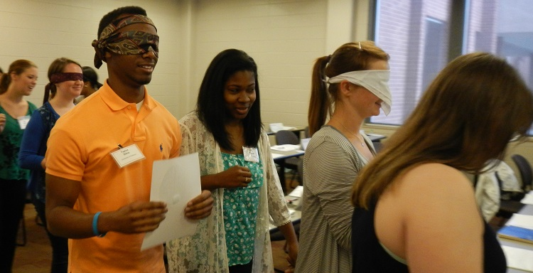 Bedsole Foundation Scholars take part in trust-building exercise during a leadership seminar session at the USA Mitchell College of Business.