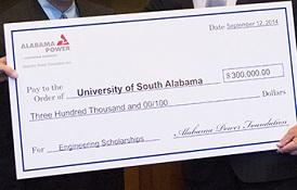 Alabama Power representatives present a check to the University of South Alabama to establish a scholars program in the College of Engineering. From left, USA President Dr. Tony Waldrop; Dr. Steven Furr, chair pro tempore of the USA Board of Trustees; Mike Saxon, Alabama Power vice president of the Mobile division; Beth Thomas, Alabama Power external affairs manager; and Abraham Mitchell, who will match the gift through the Mitchell-Moulton Scholarship Initiative.