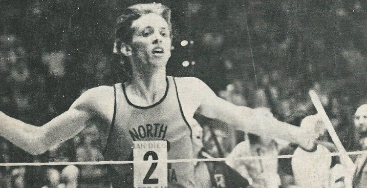 Dr. Tony Waldrop, president of the University of South Alabama, set a world record when he ran the indoor mile in just 3:55 while a student at the University of North Carolina. This photo appeared on the March 11, 1974, issue of Track & Field News.