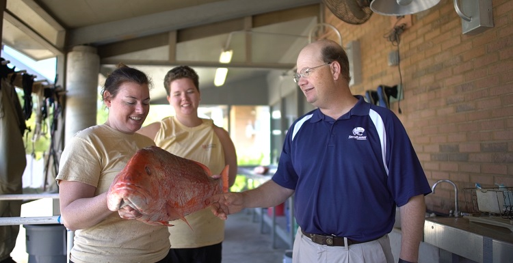 Dr. Sean Powers, right, chair of marine sciences at the University of South Alabama, is part of a $12 million independent study that includes 21 scientists from 12 institutions who will seek to determine how many red snapper live in the Gulf of Mexico.