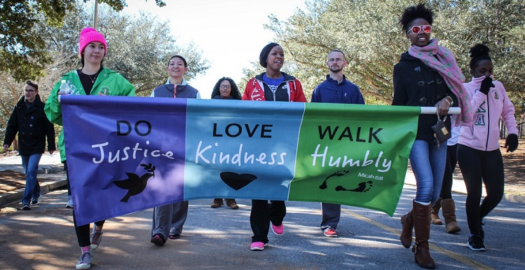 The office recently organized University involvement in activities surrounding Dr. Martin Luther King Day Jr. Day, including participation in a citywide Unity Walk relay that followed the course of the First Light Marathon.